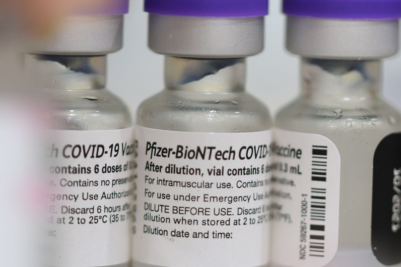 Vials of the Pfizer COVID-19 vaccine are seen at a...