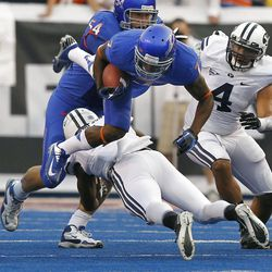 Joe Sampson (1) of the Brigham Young Cougars upends D.J. Harper (7) of the Boise State Broncos during NCAA football in Boise, Thursday, Sept. 20, 2012.