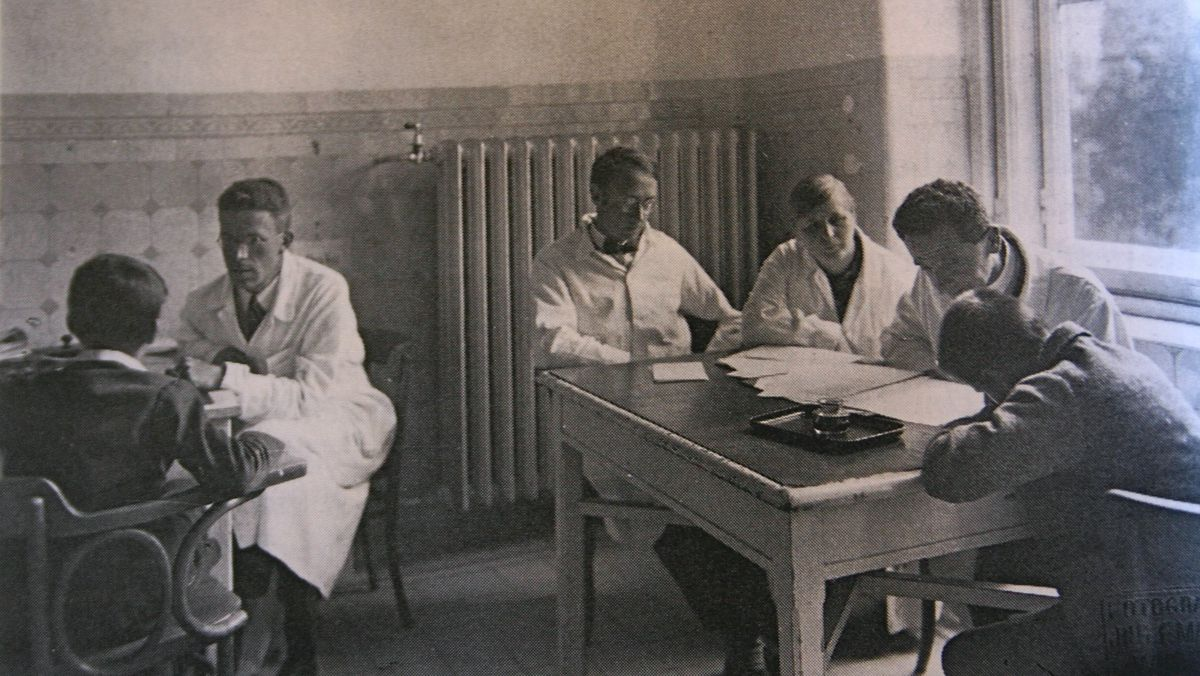 Black and white photo of four individuals