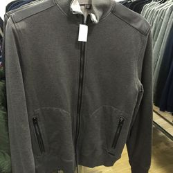 Michael Kors men's zip-up sweater with leather trim, $74 (from $295)