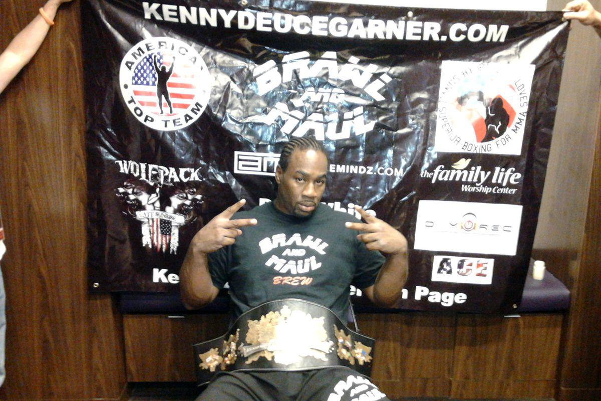 OCTOBER 14 -- Kenny Garner celebrates after defeating Maxim Grishin to earn the M-1 Interim Heavyweight belt at M-1 Challenge XXVII in Phoenix, Arizona. (Photo by Shaun Al-Shatti)