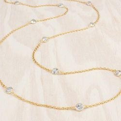 """The <a href=""""http://adornbysarahlewis.com/collections/one-of-a-kind-rings/products/floating-topaz-necklace"""">Floating Topaz Necklace</a> ($148) is bold enough to be worn on its own, but just begs to be layered."""