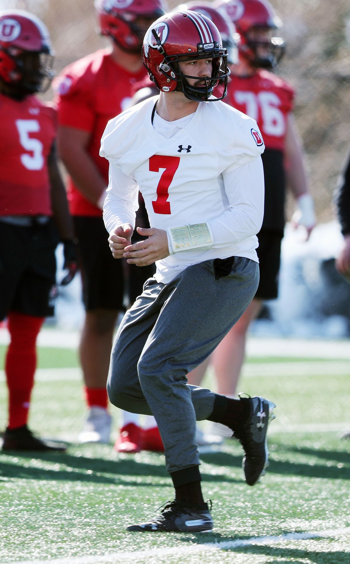 Quarterback Cameron Rising watches after handing off the ball during a drill as the University of Utah football team opens spring campat the Eccles Football Facility practice fields in Salt Lake City on Monday, March 2, 2020.