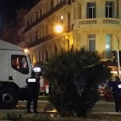 Police approach the driver's cab of a truck, in Nice, France, late Thursday July 14, 2016.  The large truck plowed through revelers gathered for Bastille Day fireworks in Nice, killing at least 84 people and sending others fleeing into the sea as it bore down for more than a mile (2 Km)  along the Riviera city's famed waterfront promenade.  The driver was killed by police and no one immediately claimed responsibility for the Thursday night attack.