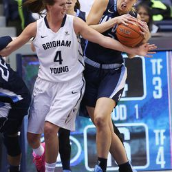 Brigham Young Cougars forward Amanda Wayment (4) fights with San Diego Toreros forward Tayla Hepburn (2) in Provo Thursday, Feb. 18, 2016.