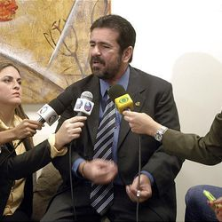 Amazonas State legislator and television show host Wallace Souza, center, speaks during a news conference in Manaus, Brazil, Tuesday.