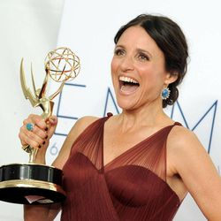 Actress Julia Louis-Dreyfus, winner Outstanding Lead Actress in a Comedy Series poses backstage at the 64th Primetime Emmy Awards at the Nokia Theatre on Sunday, Sept. 23, 2012, in Los Angeles.
