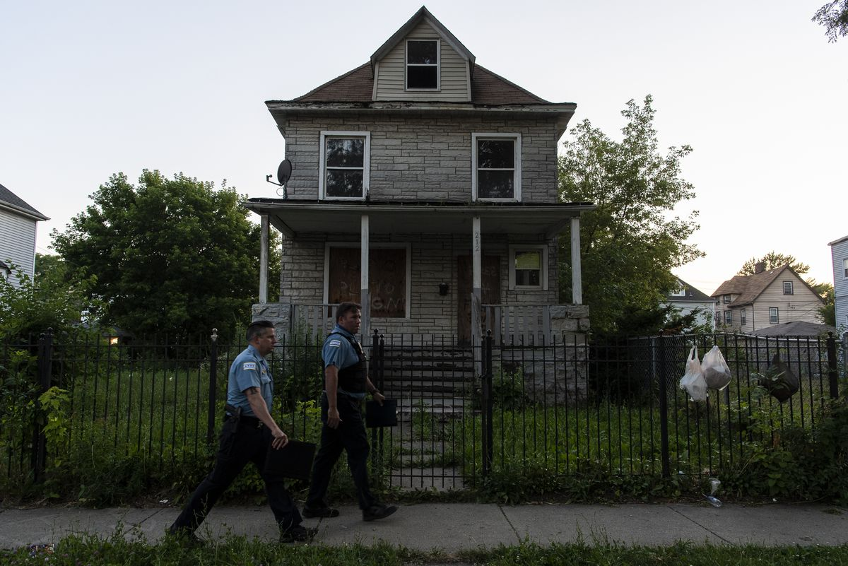 Chicago police officers in the 100 block of North Latrobe Avenue in Austin, where 7-year-old Natalia Wallace was shot to death Saturday night.