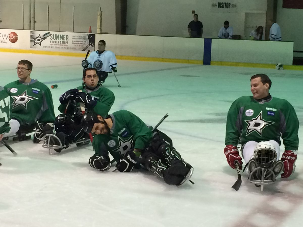 Tyler Seguin and Dallas Sled Stars group photo