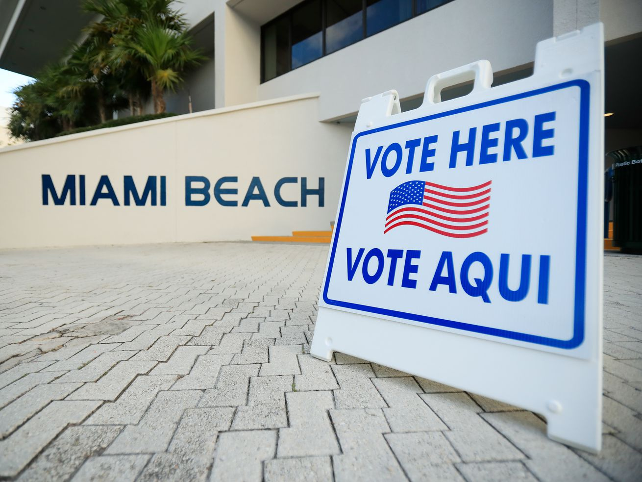 "A ""vote here"" sign seen in Miami Beach, Florida."