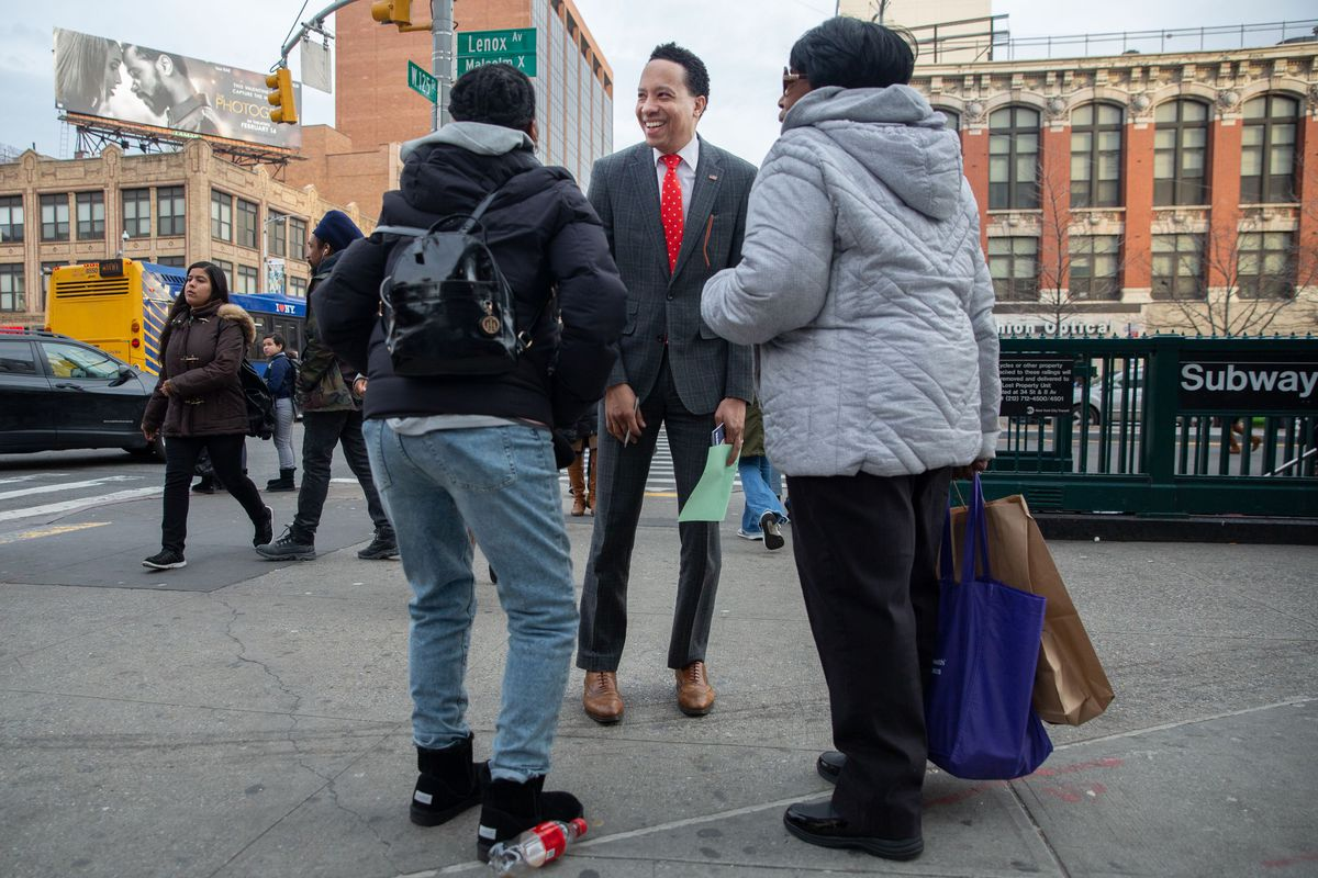 James Felton Keith speaks with voters in Central Harlem while campaigning for Congress.
