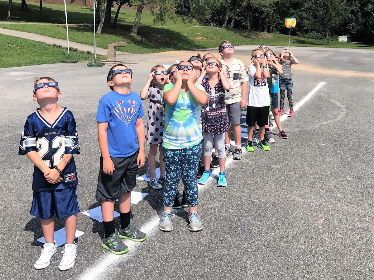 Students at Linden Elementary try on their eclipse glasses.