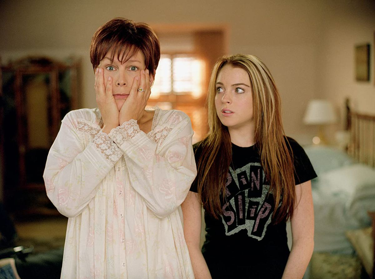 Jamie Lee Curtis clutches her face while Lindsay Lohan looks on in a screenshot from Freaky Friday