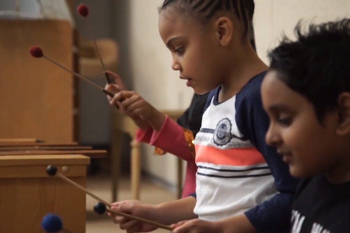Children play instruments in a classroom in a video by the School Finance Research Collaborative.