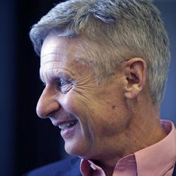 FILE - In this May 18, 2016 file photo, Libertarian presidential candidate, former New Mexico Gov. Gary Johnson speak with legislators at the Utah State Capitol in Salt Lake City.