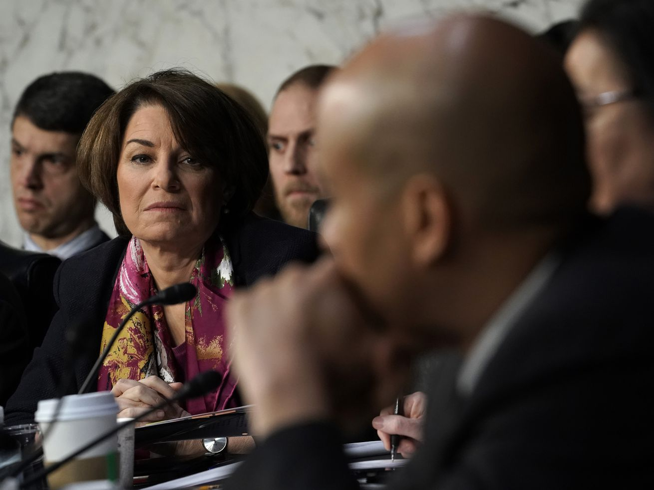 Sen. Amy Klobuchar listens to testimony during William Barr's confirmation hearing to become US attorney general in January 2019.
