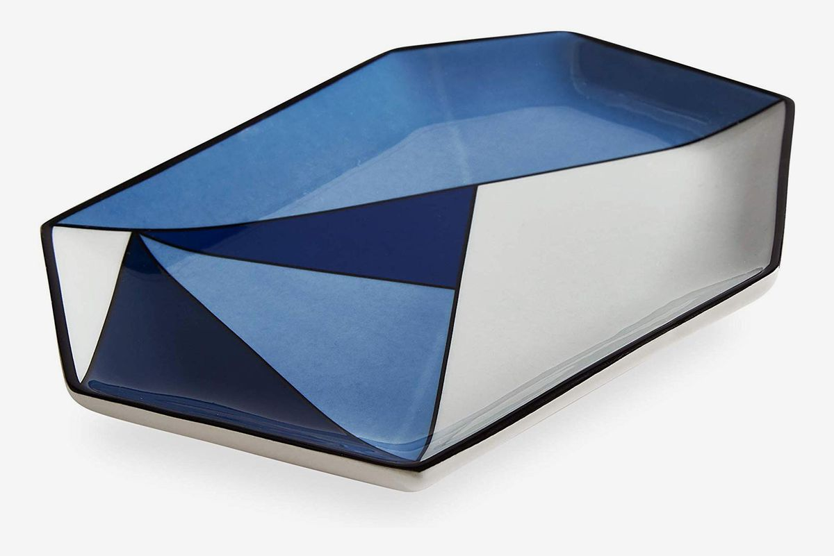 Blue and white tray with geometric patterns.