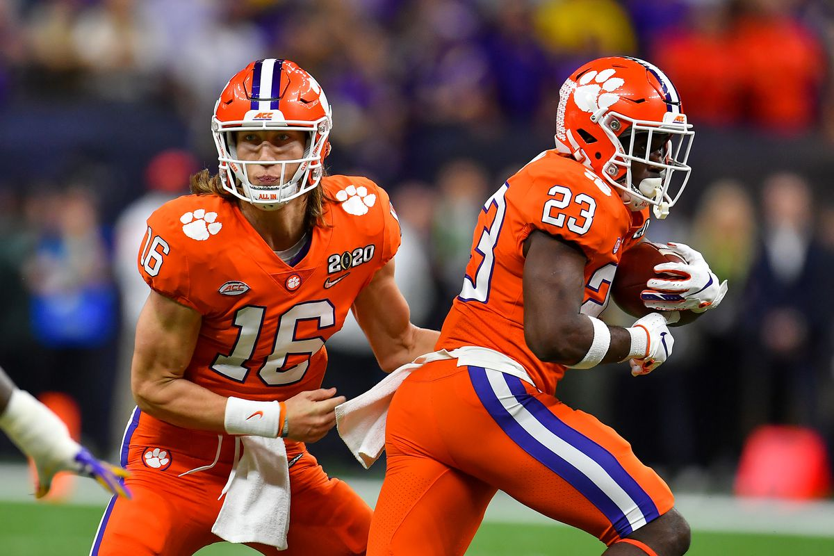 Trevor Lawrence of the Clemson Tigers hands the ball off to Lyn-J Dixon during the first quarter of the College Football Playoff National Championship game at the Mercedes Benz Superdome on January 13, 2020 in New Orleans, Louisiana.