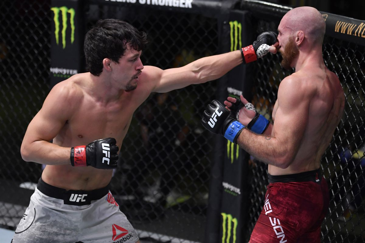 In this handout image provided by UFC, Billy Quarantillo punches Kyle Nelson in a featherweight fight during the UFC Fight Night event at UFC APEX on September 12, 2020 in Las Vegas, Nevada.