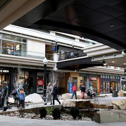 People walk around the City Creek Center in Salt Lake City on Wednesday, March 22, 2017. The development is marking its five-year anniversary.