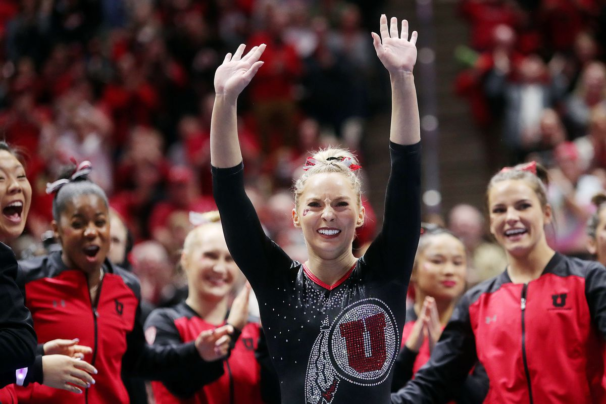 MyKayla Skinner waves to the crowd after scoring a perfect 10 on her floor routine as Utah and Michigan battle it out in Gymnastics at the Huntsman Center in Salt Lake City on Saturday, March 2, 2019.