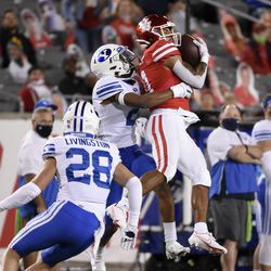 Houston wide receiver Tre'von Bradley, right, catches a pass as BYU defender Keenan Ellis defends during the first half of an NCAA college football game on Friday, October 16, 2020 in Houston.