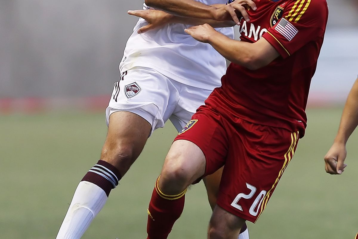 SANDY, UT - JULY 21: Ned Grabavoy #20 of Real Salt Lake and Tony Cascio #32 of the Colorado Rapids fight for the ball during the second half of an MLS soccer game July 21, 2012 at Rio Tinto Stadium in Sandy, Utah. (Photo by George Frey/Getty Images)