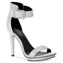 """<b>Calvin Klein</b> Vivian High Heel Sandals in White Graphic Lizard, <a href=""""http://www1.macys.com/shop/product/calvin-klein-womens-vivian-high-heel-sandals?ID=757426&PartnerID=LINKSHARE&cm_mmc=LINKSHARE-_-2-_-21-_-MP221&LinkshareID=J84DHJLQkR4-LQ.FVtxI"""