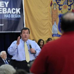 In this March 29, 2012 photo, New Jersey Gov. Chris Christie answers a question at a town hall meeting in Manchester, N.J. Part stump speech, part quiz show, part comedy hour, Chris Christie's town halls are probably not what Norman Rockwell envisioned in his famous 1943 painting of an assembly where people come to air their grievances and an elected official listens patiently. Yet the time-old tradition of the town hall has become the hallmark of Christie's administration and helped make him a rising Republican star.