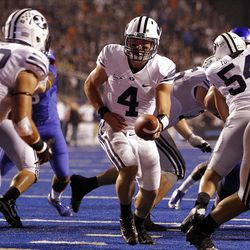 Taysom Hill of the Brigham Young Cougars hands off to Michael Alisa, left, during NCAA football in Boise, Thursday, Sept. 20, 2012.