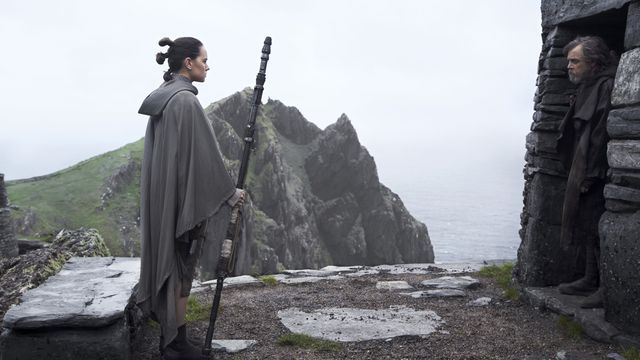Daisy Ridley as Rey (left) and Mark Hamill as Luke Skywalker in <em>Star Wars: The Last Jedi</em>.