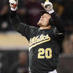 Oakland Athletics' Josh Donaldson celebrates after hitting a two-run home run off Boston Red Sox's Aaron Cook in the second inning of a baseball game Friday, Aug. 31, 2012, in Oakland, Calif.
