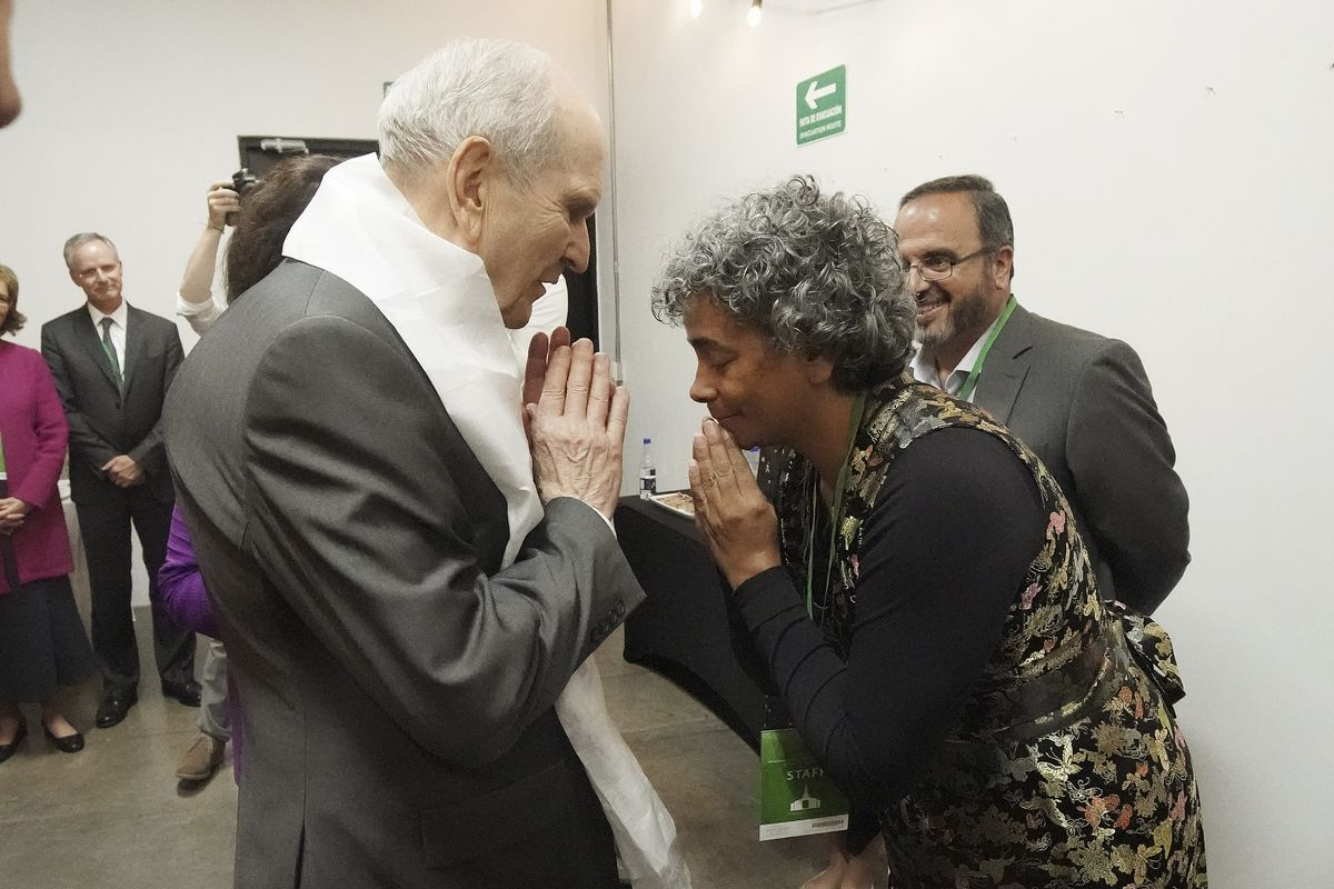 President Russell M. Nelson of The Church of Jesus Christ of Latter-day Saints is given a khata by Olga Lucia Sierra with the Tiberian Budism of Columbia in Bogota, Colombia, on Sunday, Aug. 25, 2019.