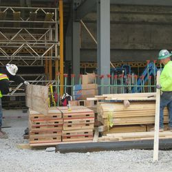 11:31 a.m. Worker removing nails from the wood boards for reuse -
