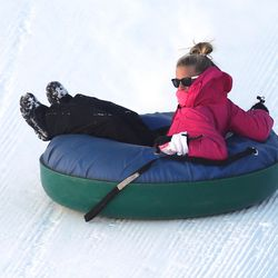 Sabrina Roberts, from California, as she tries extreme tubing down ski jump hills at Utah Olympic Park near Park City Saturday, Dec. 26, 2015, in Synderville Basin.