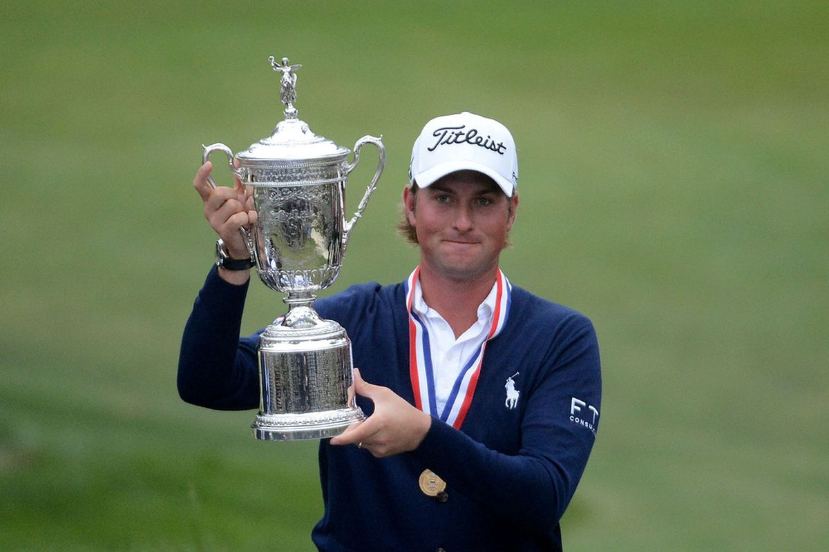 SAN FRANCISCO, CA - JUNE 17:  Webb Simpson of the United States celebrates with the trophy after his one-stroke victory at the 112th U.S. Open at The Olympic Club on June 16, 2012 in San Francisco, California.  (Photo by Harry How/Getty Images)