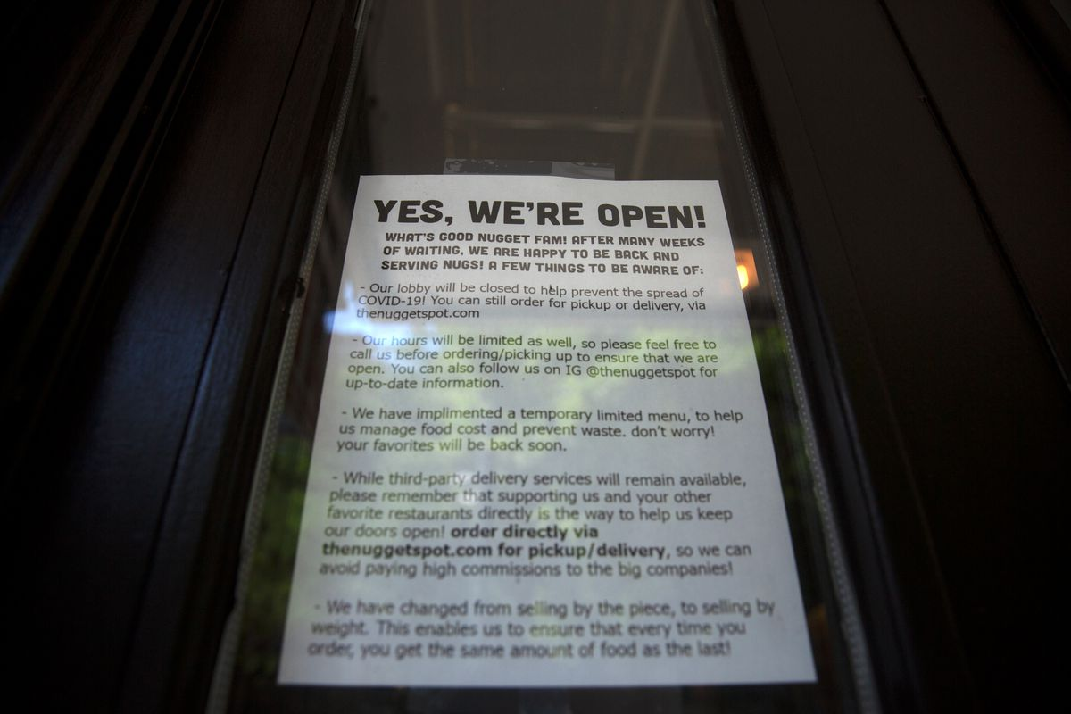 The Nugget spot on East 14th Street lets customers know how they're operating during the coronavirus partial reopening, July 15, 2020.
