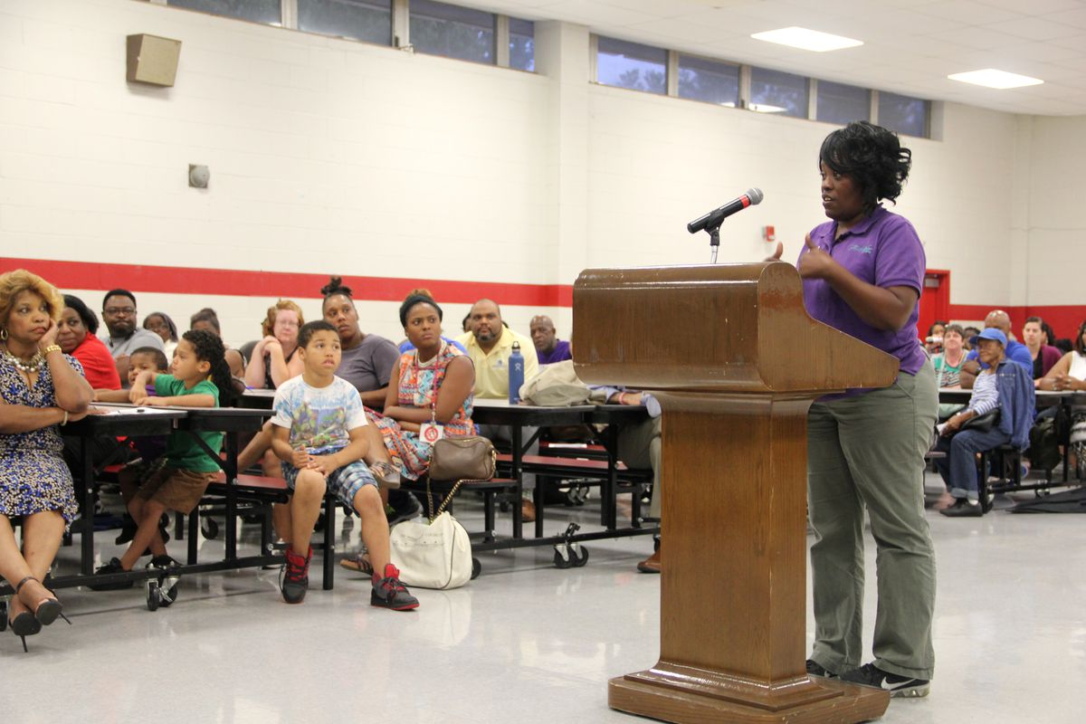 Hawkins Mill parent Alicia Tomlinson speaks to the gathering of some parents but mostly teachers.