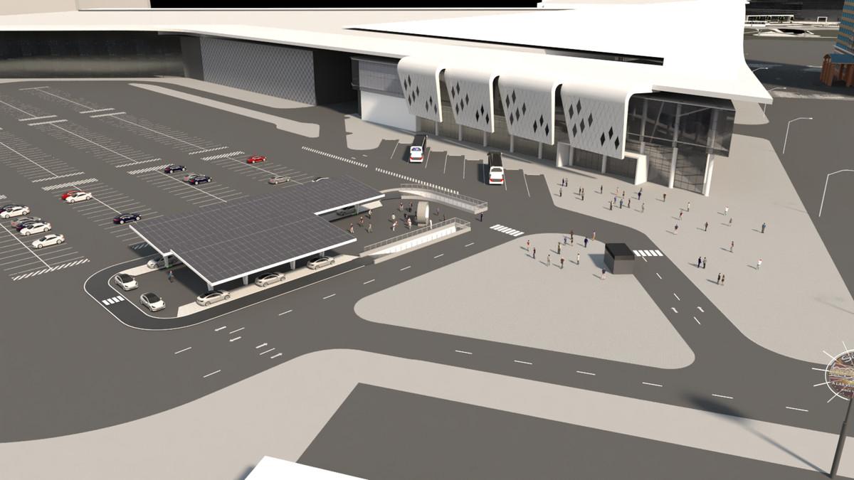 Un rendu d'une station Vegas Loop de Boring Company dans un parking du centre des congrès, qui ressemble à un valet pour voitures.