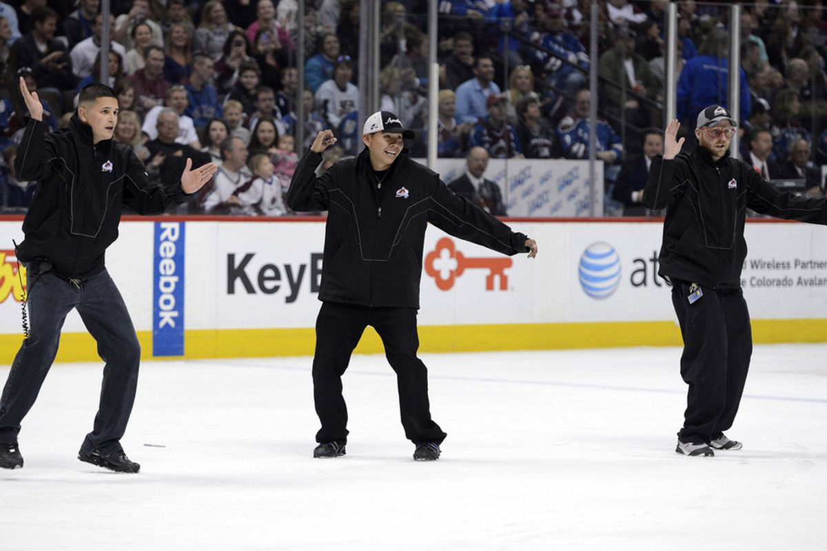 April 7 2012; Denver, CO, USA; Members of the Colorado Avalanche conversion team dance for the fans during the second period against the Nashville Predators  of the game at the Pepsi Center. Mandatory Credit: Ron Chenoy-US PRESSWIRE