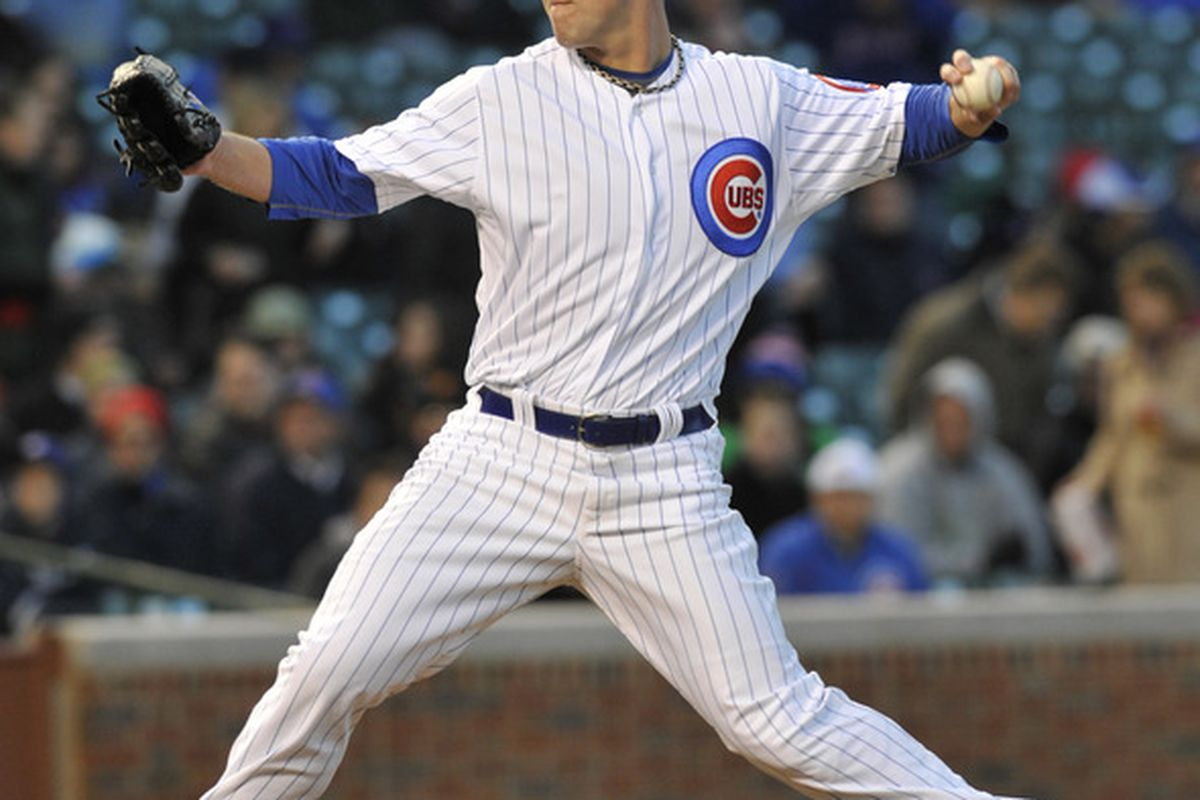 Paul Maholm of the Chicago Cubs pitches against the Milwaukee Brewers at Wrigley Field in Chicago, Illinois.  (Photo by David Banks/Getty Images)