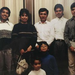 The family of Candelario and Josefina Lopez are photographed around the time of their baptism in 1989.