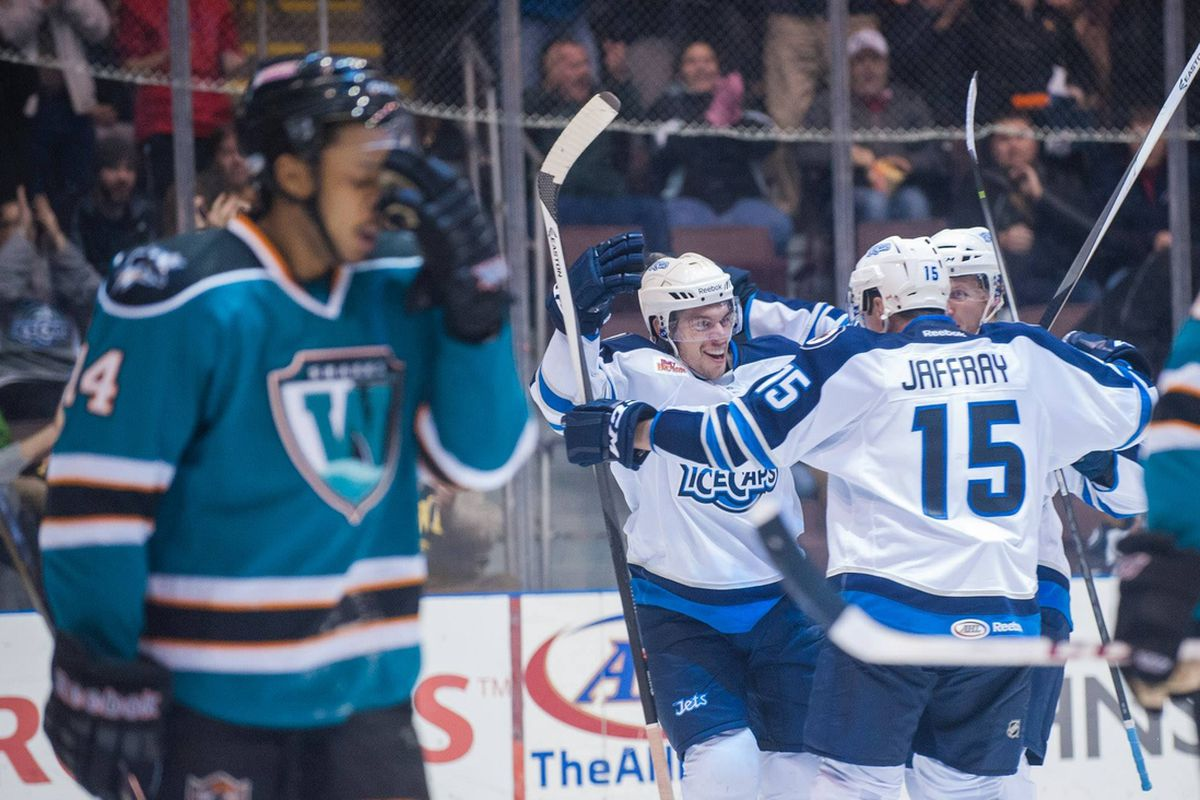 Worcester Sharks defenseman Sena Acolatse reacts as the St. John's IceCaps celebrate Jerome Samson's short handed goal that tied the game late in the third period.