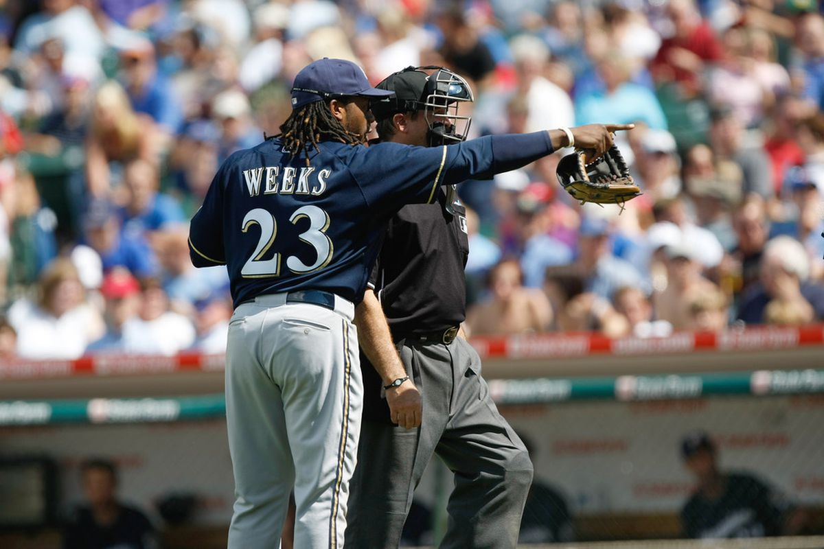 Rickie Weeks and umpire Ed Rapuano discuss that base where he keeps getting thrown out.