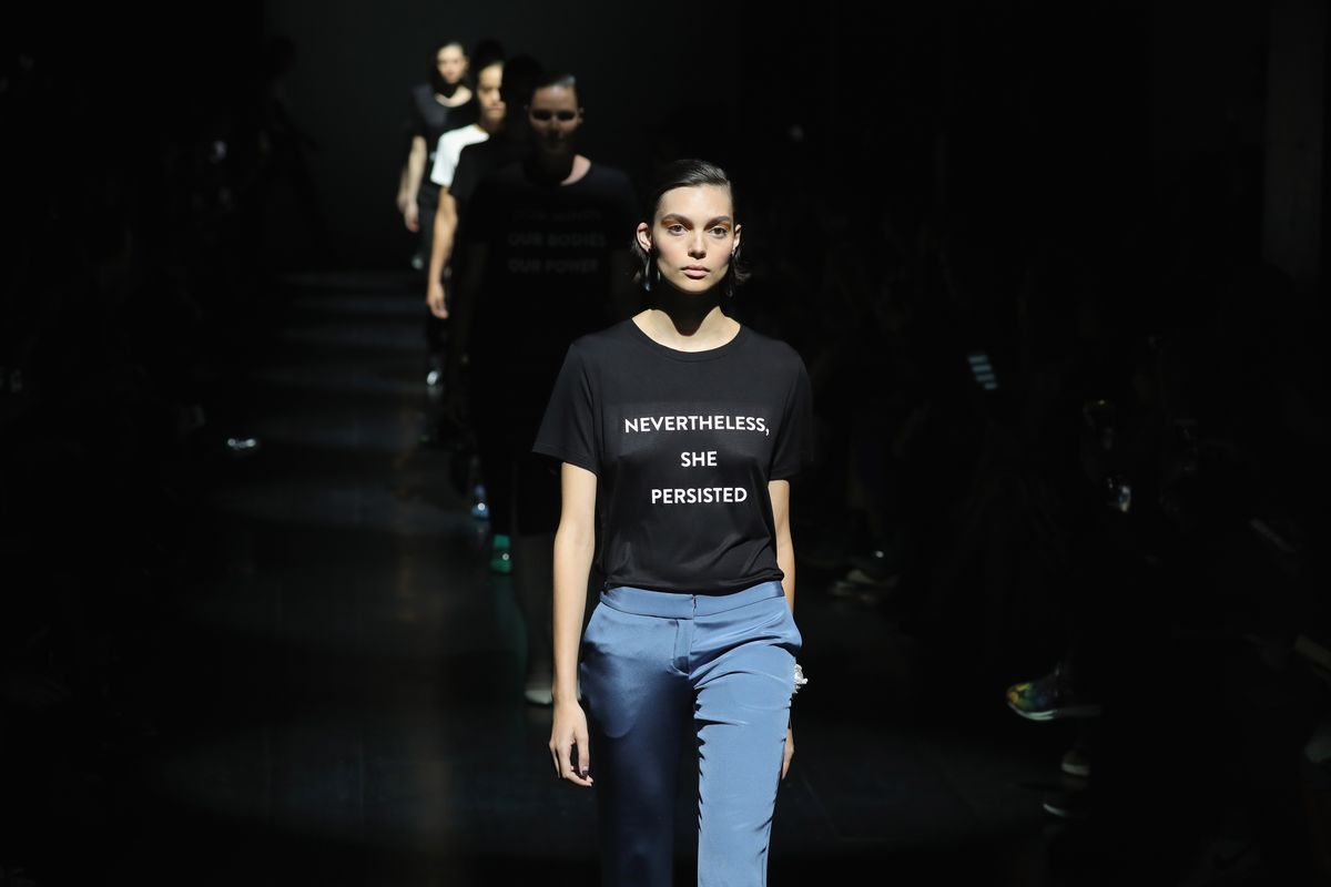 """A model wears a """"Nevertheless, She Persisted"""" shirt."""