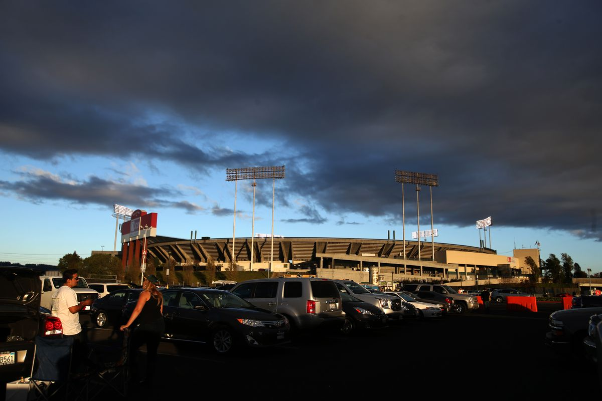 Darks clouds float above O.co Coliseum in Oakland, Calif., before an MLB game between the Oakland Athletics and the Texas Rangers on Wednesday, Sept. 17, 2014. (Ray Chavez/Bay Area News Group)