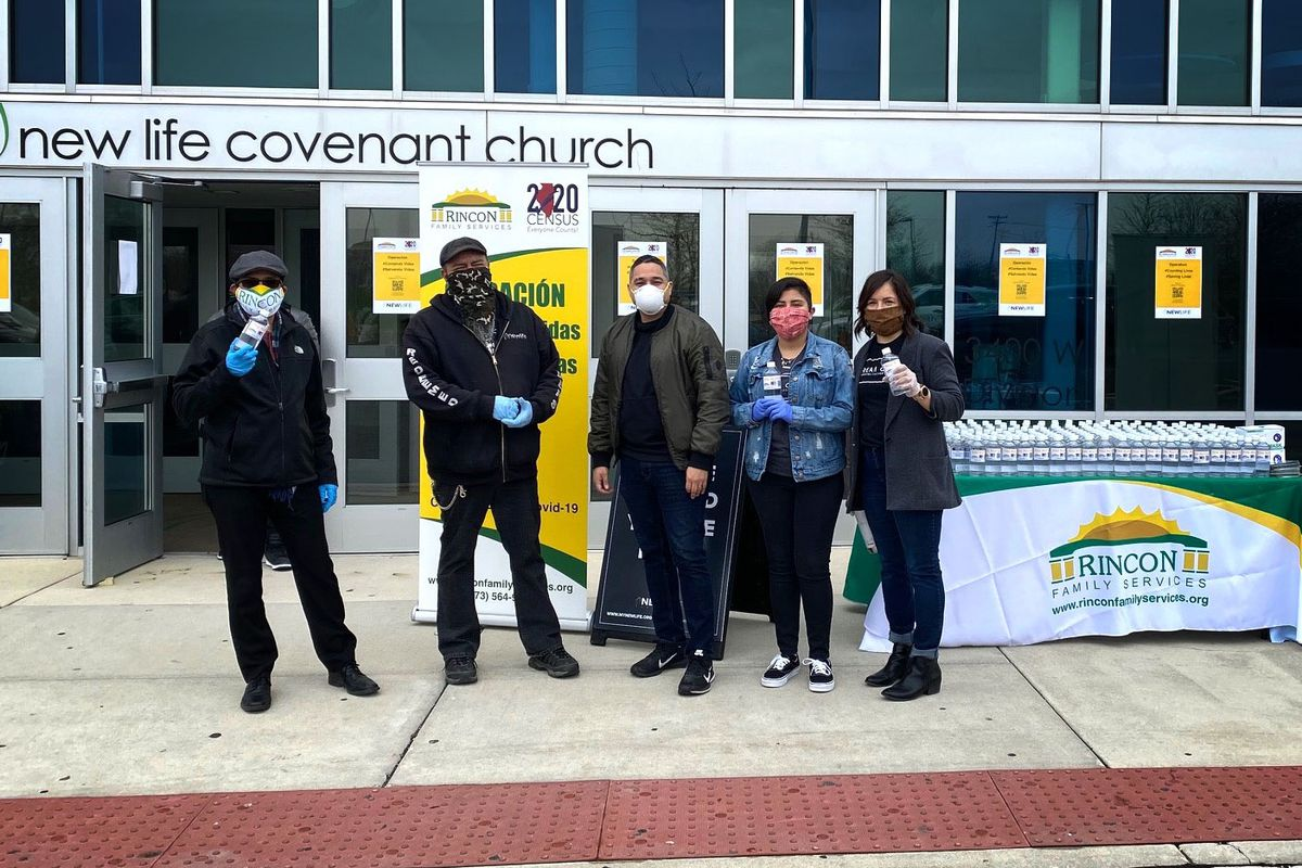 Organizers with Rincon Family Services began pass out 55 gallons of hand sanitizer Thursday, April 23, 2020, outside the New Life Covenant Church, 3400 W. Division.