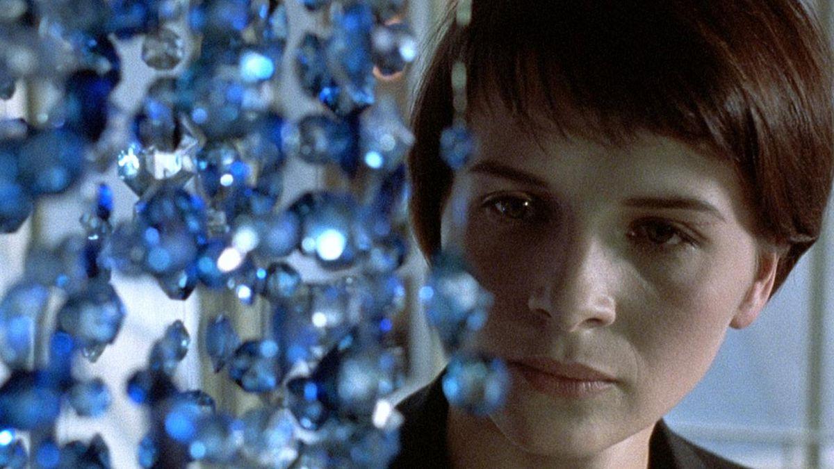 Juliette Binoche looks at a blue chandelier in Three Colors: Blue.