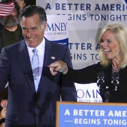 Republican presidential candidate, former Massachusetts governor Mitt Romney and his wife Ann arrive to cheers as they greet supporters  Tuesday, April 24, 2012, in Manchester, N.H. (AP Photo/Jim Cole)