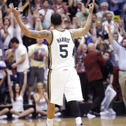 Utah Jazz guard Devin Harris (5) reacts after hitting a three point shot  with 37.9 seconds left in overtime as the Utah Jazz and the Orlando Magic play Saturday, April 21, 2012 in Energy Solutions arena. Jazz won 117-107.
